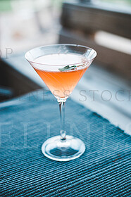 peach martini in glass